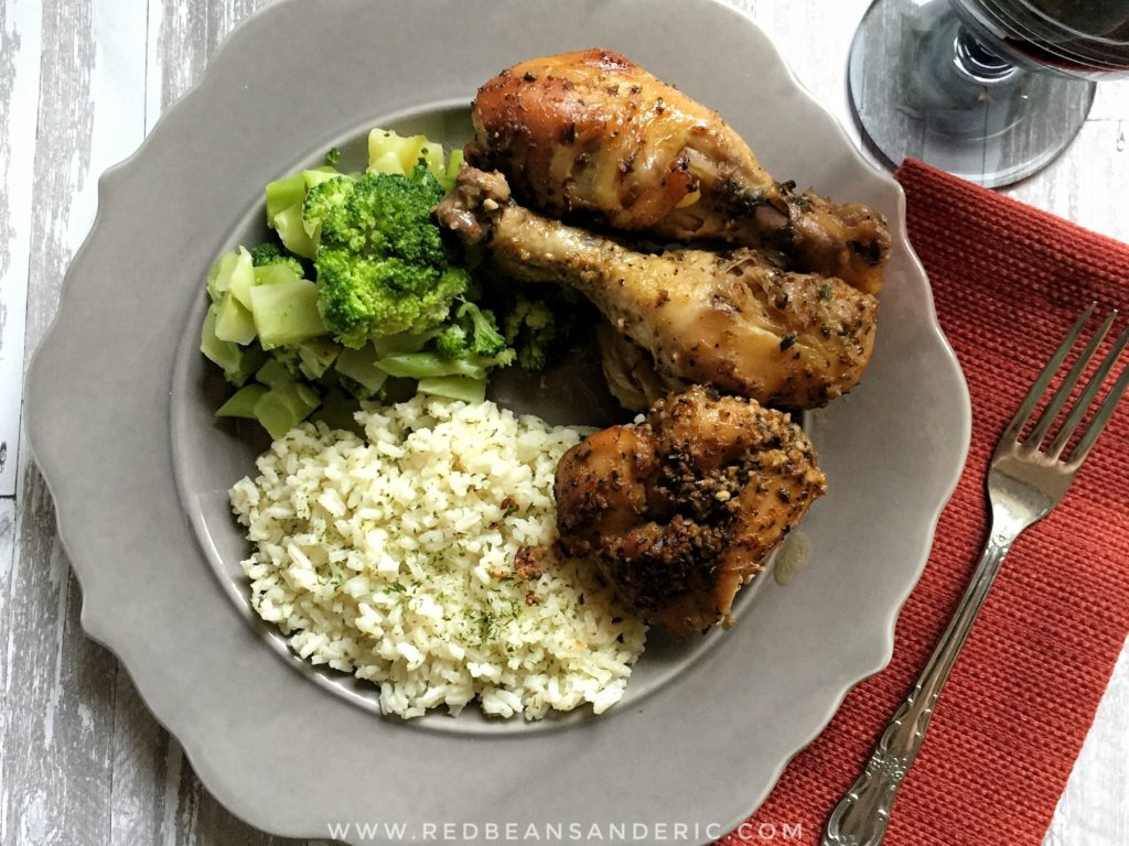 A plate of Chicken Drumsticks da Pope along with broccoli and Lemon Parsley Rice