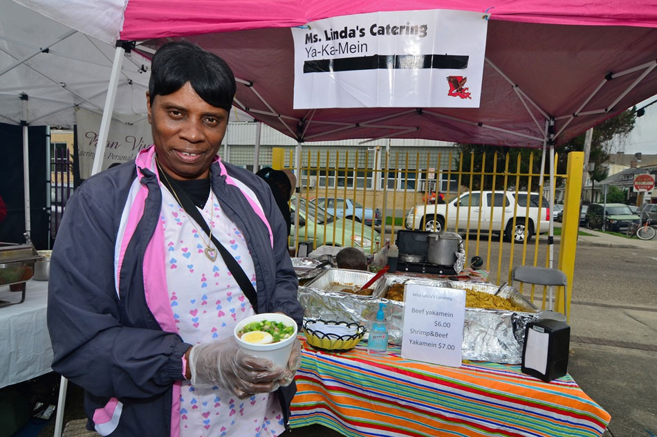 Ms Green the Yakamein Lady outside of her booth at an event