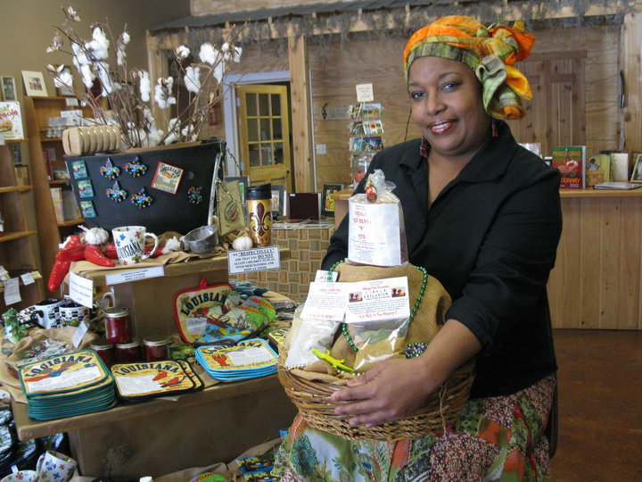 Cookbook author and business owner, Panderina Soumas, holds a gift basket of her Creole products