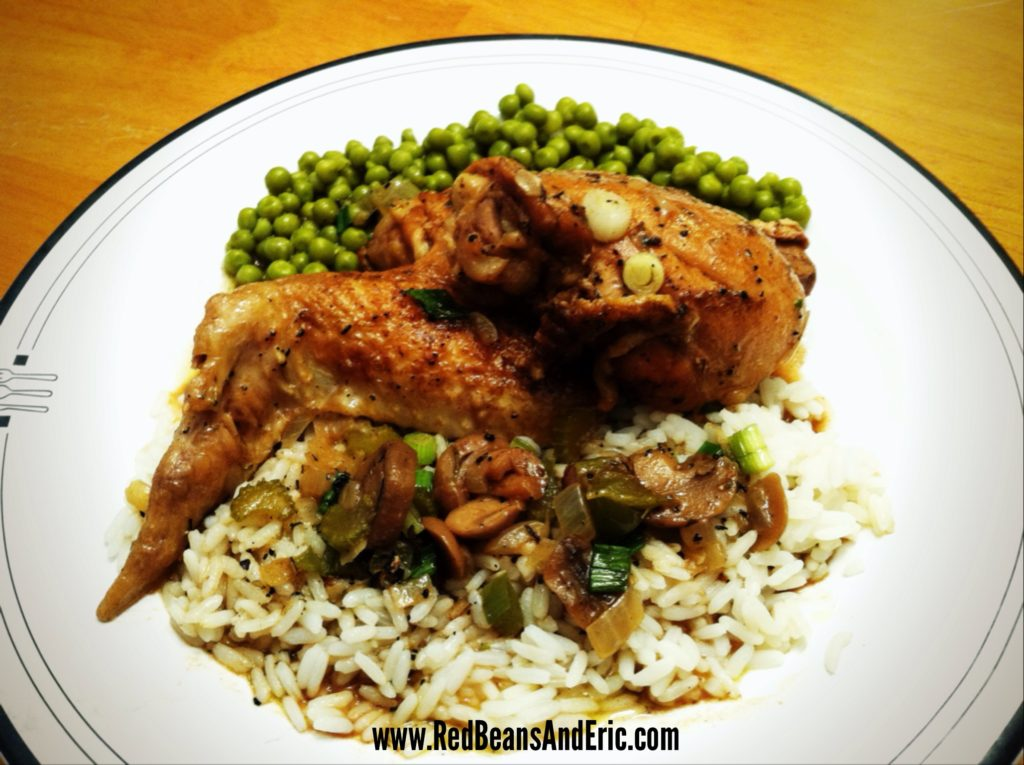 New Orleans style Stewed Chicken over hot white rice and a side of green peas
