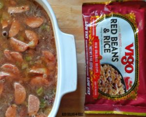 Mixed Vigo red beans and rice and water in 9x9 casserole dish