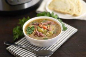 A bowl of ham and lentil soup